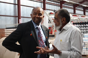 Iqbal Tayob explains the manufacturing process to Mr Qhena