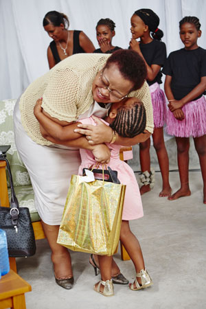 Northern Cape premier Sylvia Lucas receives a gift from the local community