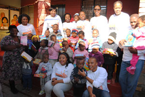 IDC staff pose with children at Mpumelelo Day Care centre