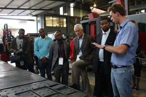 IDC CEO Mvuleni Geoffrey Qhena and his delegation listen closely as the process of working with Voortman machinery is explained to them. (Photo: Elias Nkabinde)