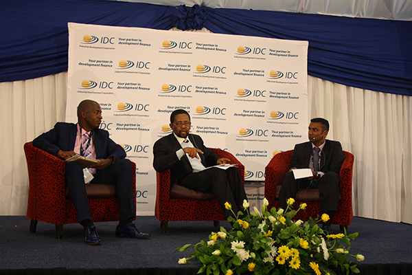 IDC Regional Manager Mashweu Matsiela, IDC CEO Geoffrey Qhena and Head of IDC Operations Head Office Manoj Seonath respond to the audience during the question-and-answer session. (Photo: Elias Nkabinde)